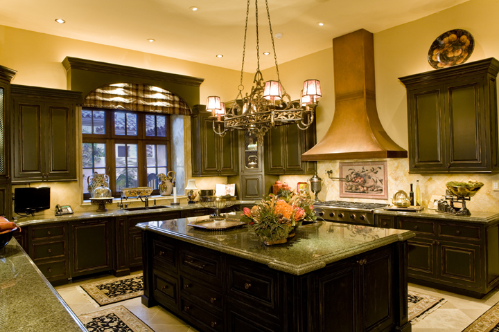Projects spanish colonial in la quinta ca for Kitchen cabinets in spanish